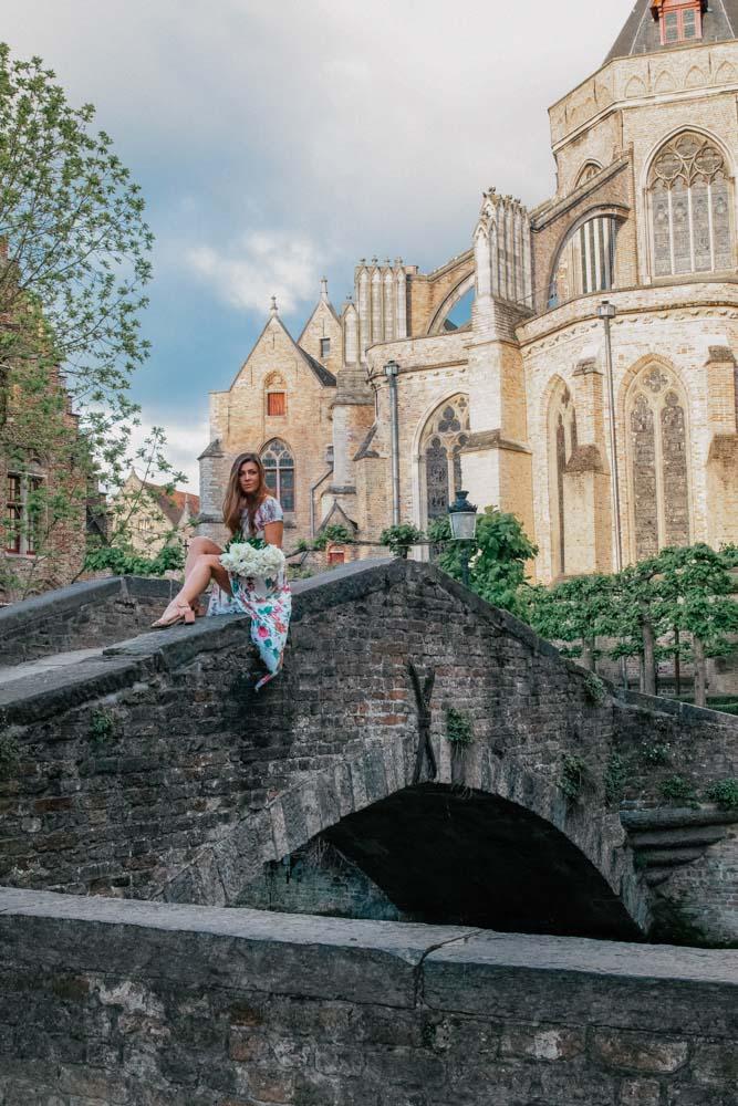 Melissa sitting on the Bonifacius Bridge in Brugges