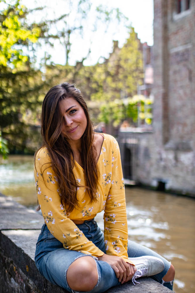 Melissa sitting next to the Bruges canal
