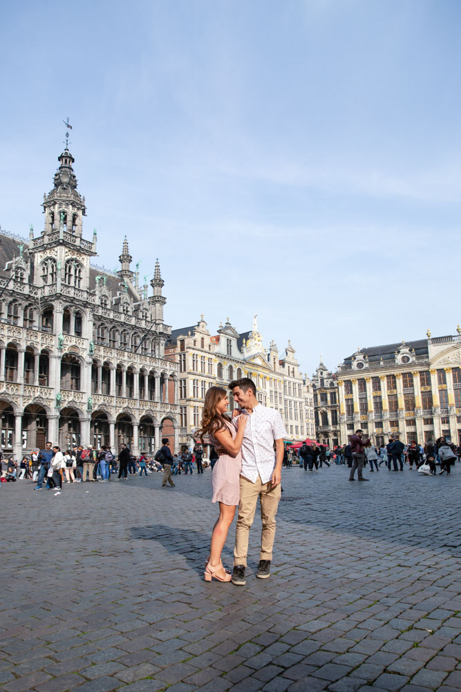 Melissa and Guga hugging at the grand place, one of the top attractions in Brussels