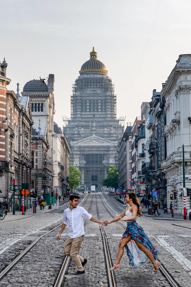 Girl Around the World crossing the road in front of the Palace of Justice with Guga