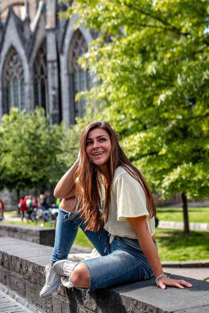Melissa sitting in front of St. Michael's Cathedral in Ghent