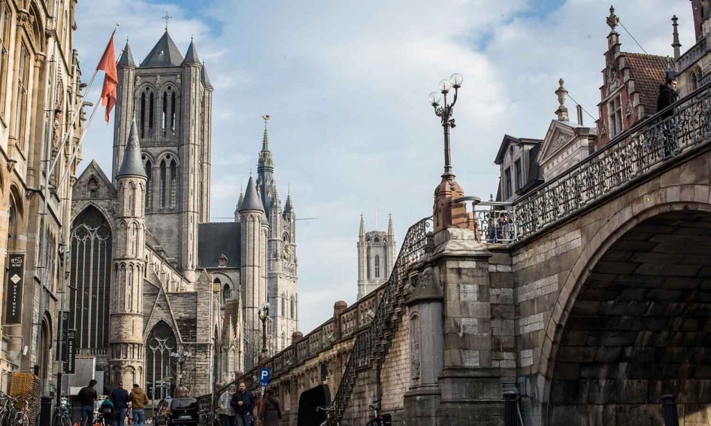 Photo of the St. Michael's Bridge with the St. Nicholas Church in the background, Ghent
