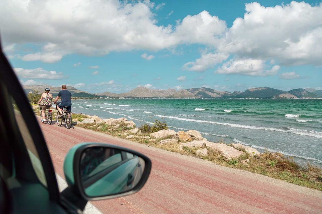 Couple biking around Palma de Mallorca Spain