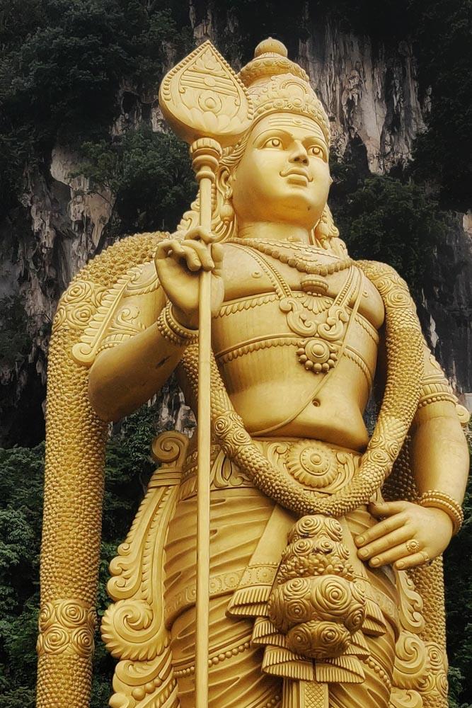 The golden status of the Hindu god LordMurugan at the Batu Caves in Kuala Lumpur, Malaysia.