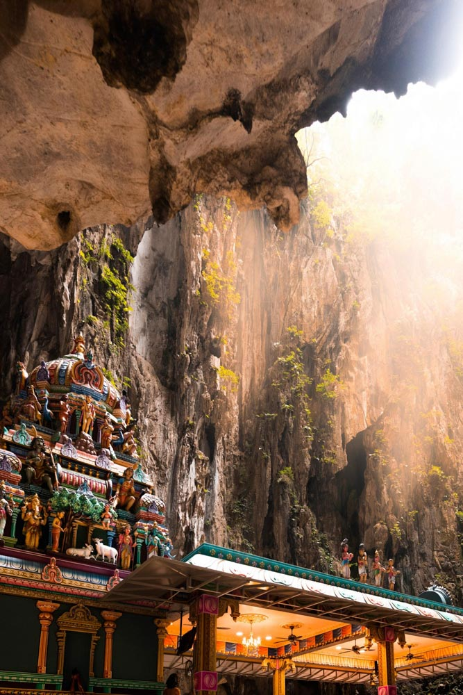 Sunlight streams into the Temple Cave of the Batu Caves in KL, Malaysia.