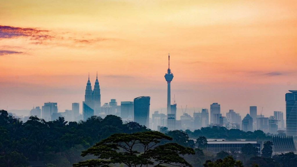 Landscape of Kuala Lumpur with the KL Tower in the foreground during sunset