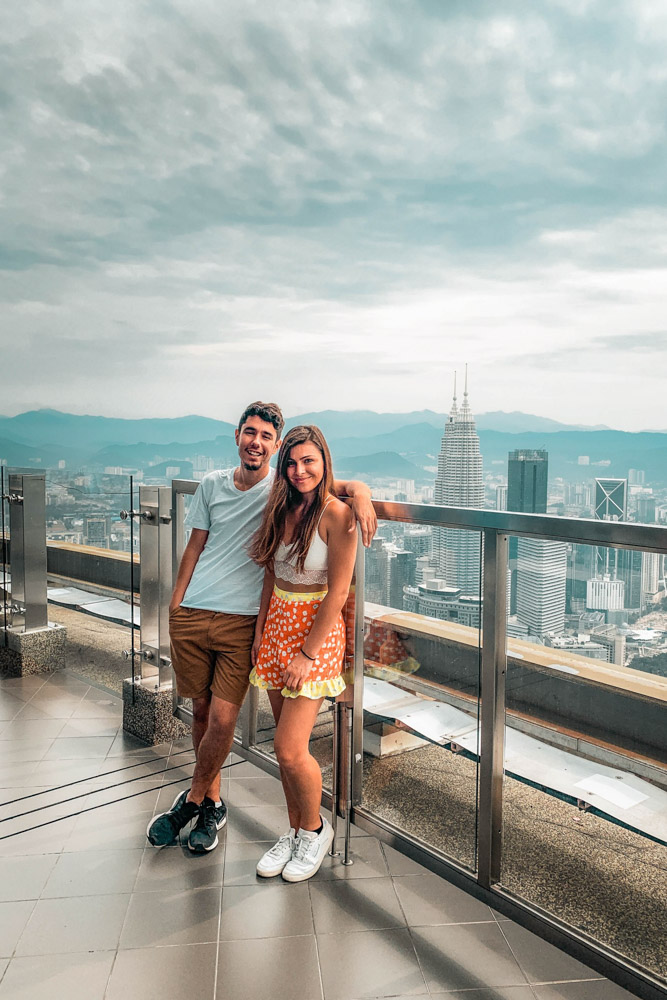 Melissa and Guga pose for a photo on the Sky Deck at the Menara KL Tower.
