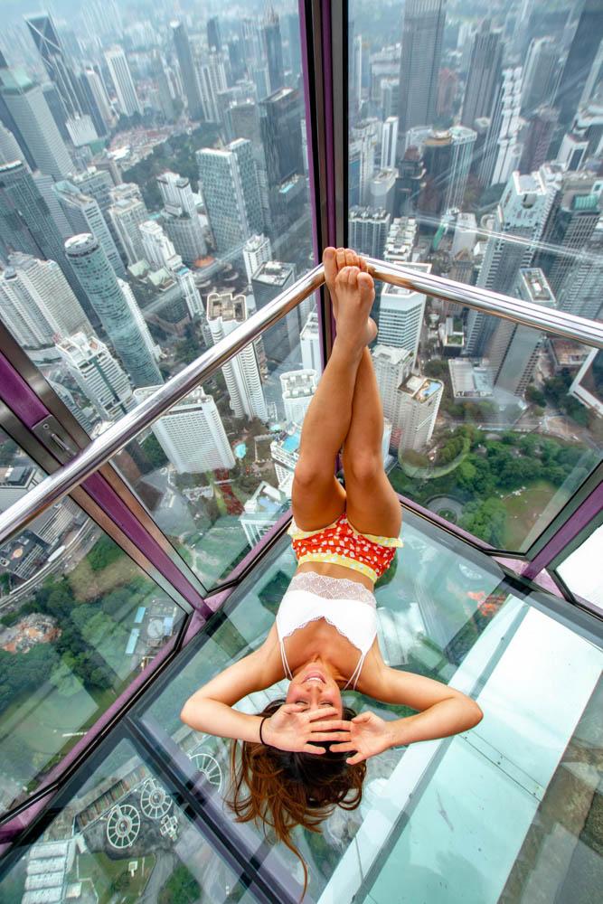 Melissa sitting inside the Sky Box in the Menara Tower in Kuala Lumpur