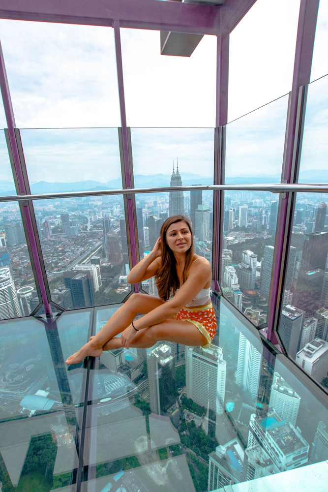 Melissa sitting in the Sky Box at the KL Tower in Kuala Lumpur