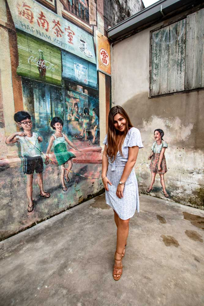 Melissa stands in the cool graffiti streets of Chinatown in KL.