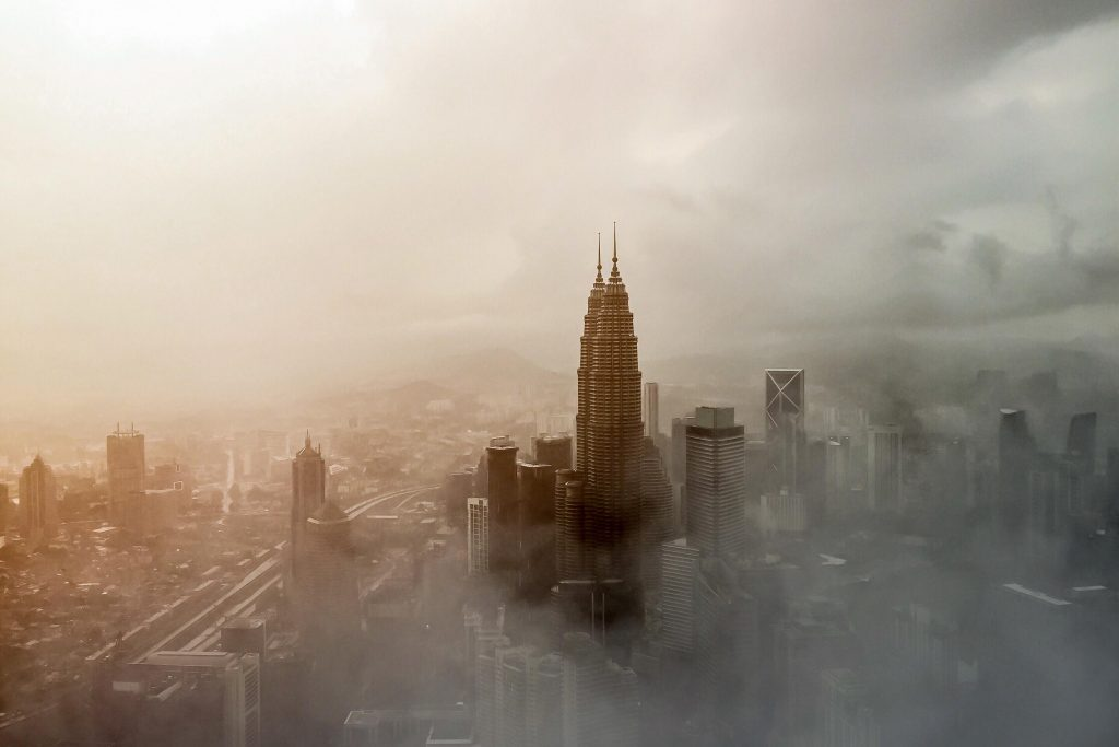 Petronas towers in a foggy day in Kuala Lumpur