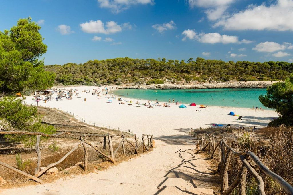 S'Amarador Beach on a sunny summer day