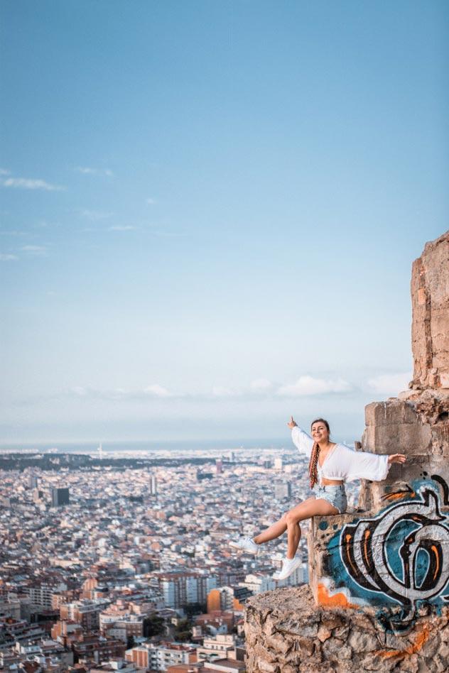 Melissa sitting at the edge on the Bunker El Carmel in Barcelona