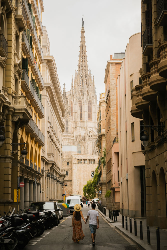 Girl Around the World and Guga in an alleway leading to the Barcelona Cathedral