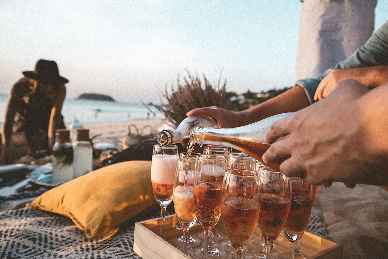 Man pouring drinks at a beach club in Palma de Mallorca
