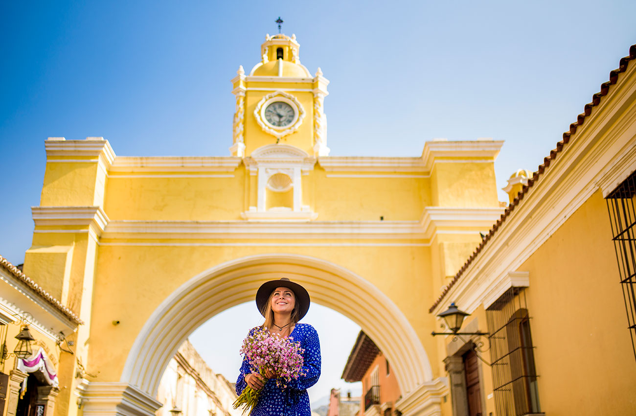 Melissa under the arch in Antigua, one of the best things to do in Antigua Guatemala