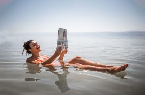 Melissa floating on the Dead Sea, one of the highlights of doing a Dead Sea trip