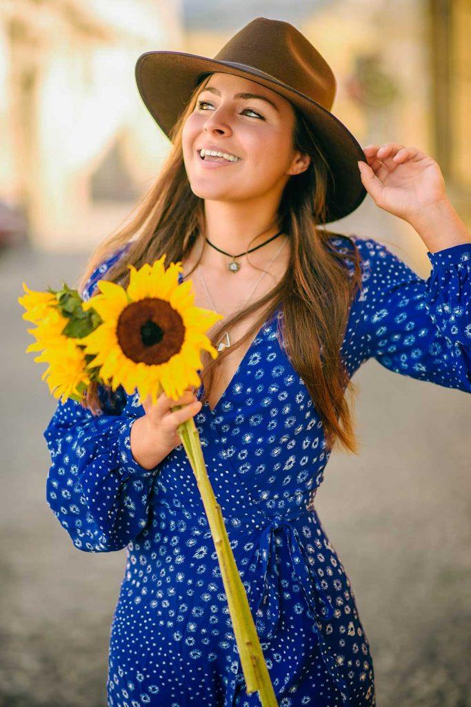 Melissa holding a sunflower in Antigua Guatemala