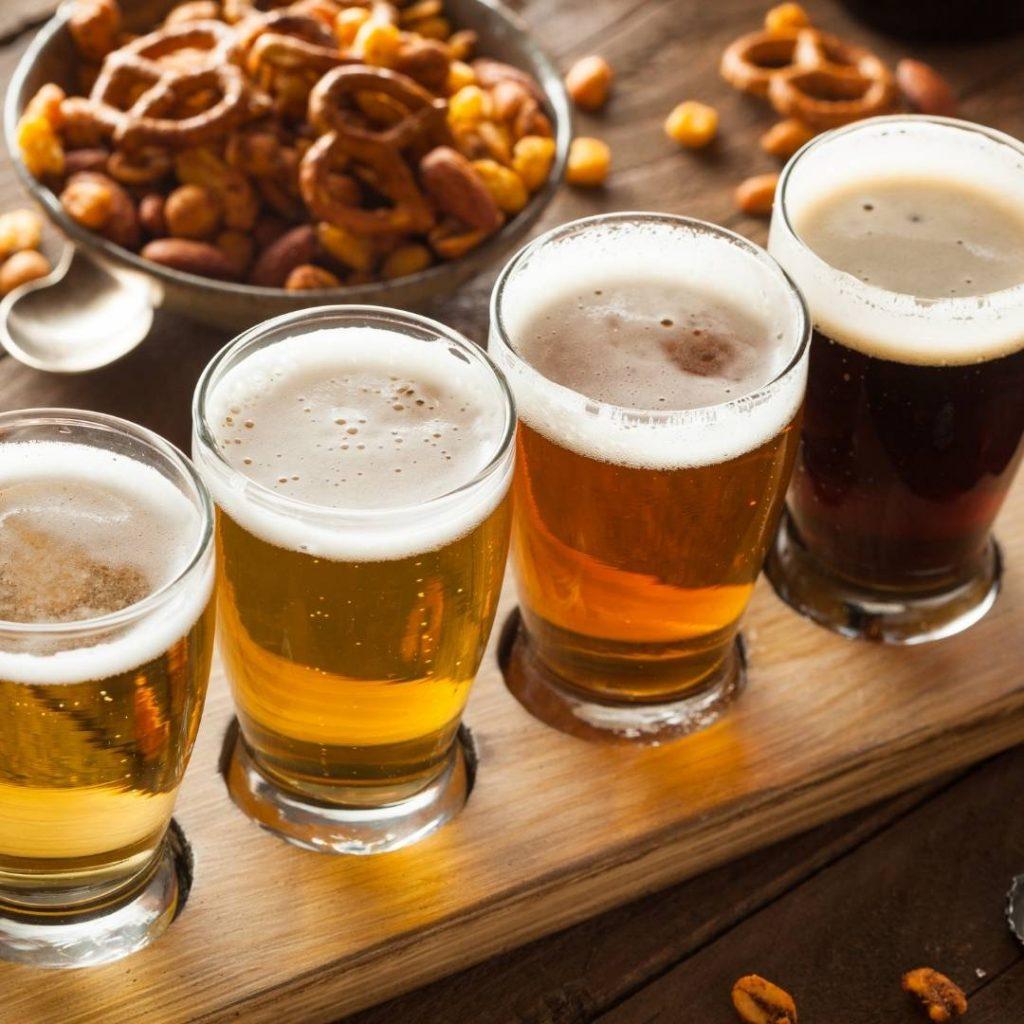 pints of beer lined up on a bar, bruges