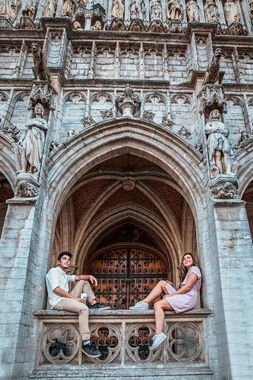 Melissa and Girl Around the World sitting under an archway in the Grand Place in Brussels