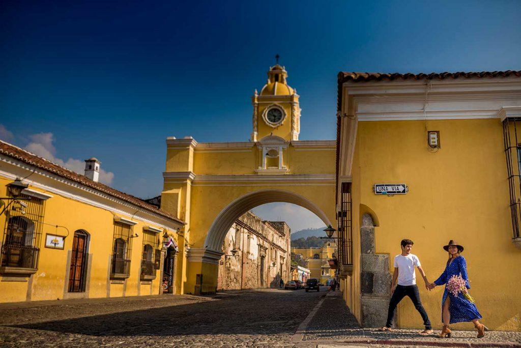 Girl Around the World and Guga in front of El Arco de Santa Catalina in Antigua Guatemala