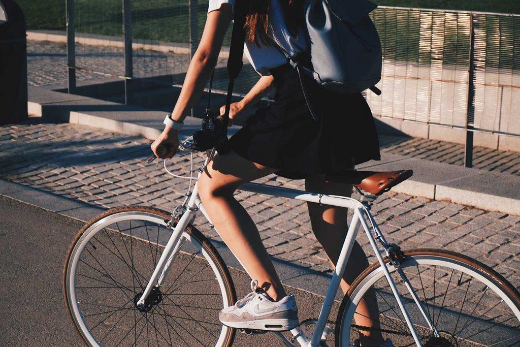 Girl riding a bike around Brussels, Belgium