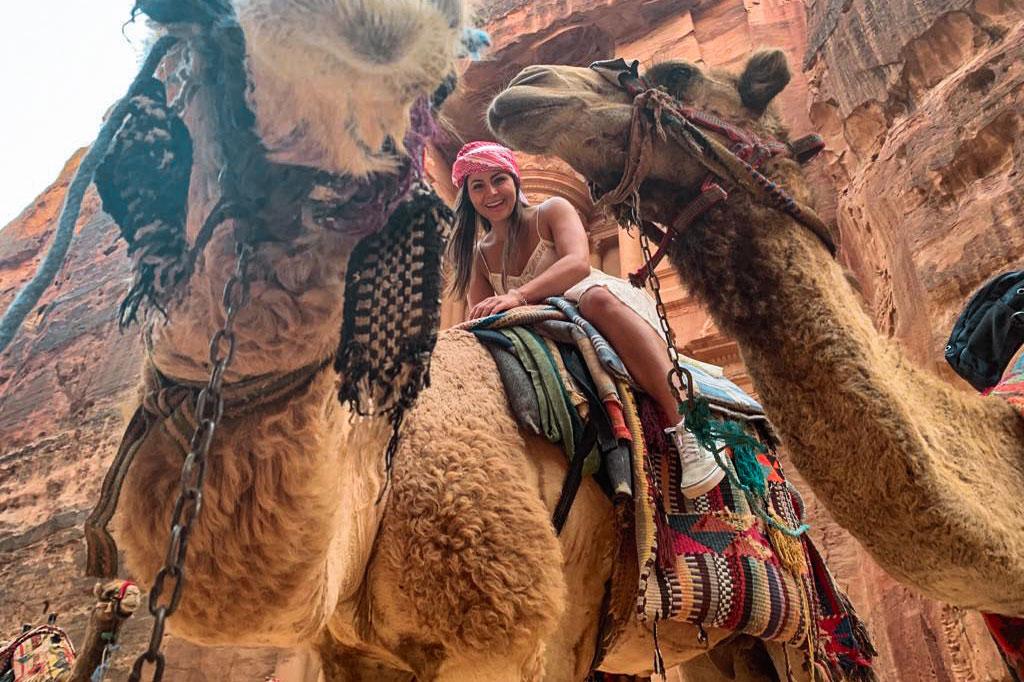 Melissa sitting on top of a camel in Petra Jordan