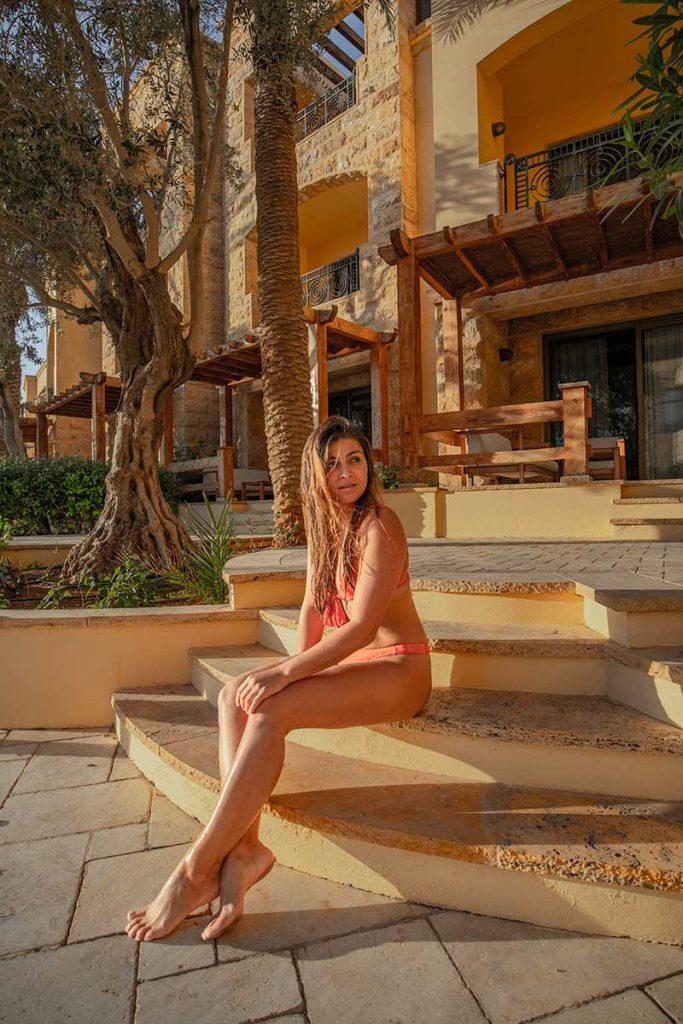 Melissa sitting on the stairs outside Kempinski Hotel Ishtar Dead Sea