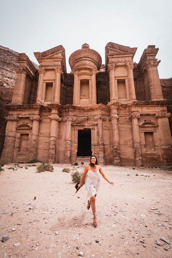Girl Around the World standing in front of the Monastery in Petra Jordan