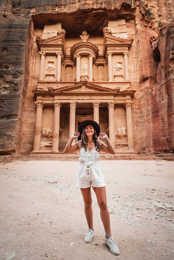 Girl Around the World in front of the treasury in petra jordan