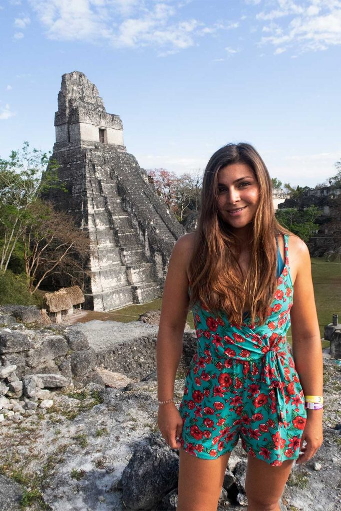 Melissa standing in front of Tikal Ruins in Guatemala