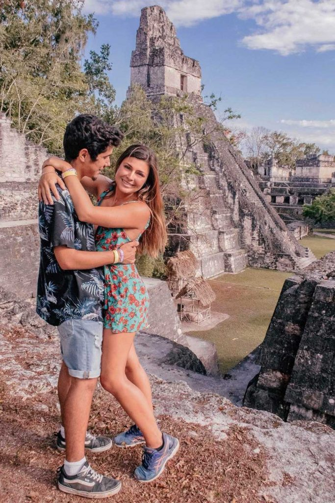 Melissa and Guga hugging with Tikal Ruins on the background