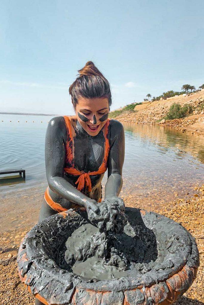 Melissa covered in the dead sea mud in jordan