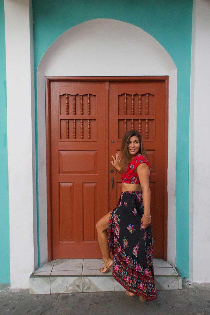 Melissa standing in front of a door in Flores Guatemala