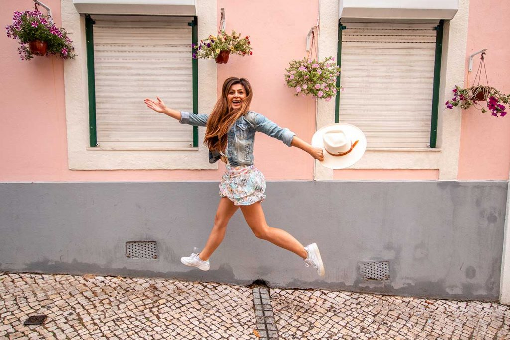 Melissa jumps for joy in the streets of Lisbon