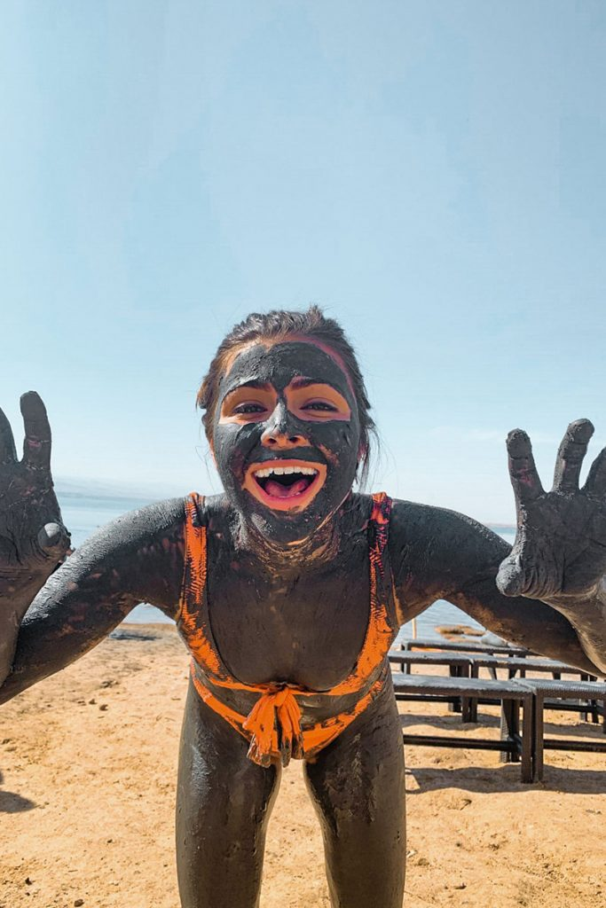 Melissa looking at the camera with Dead Sea Mud in Jordan
