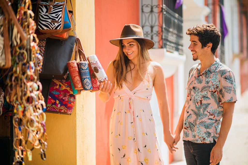 Girl Around the World and Guga shopping for souvenirs in Antigua