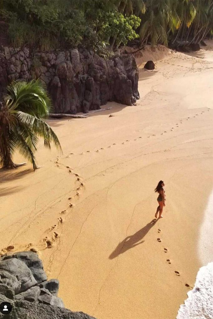 melissa walking down the beach in sao tome and principe