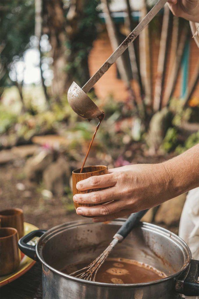 person serving cocoa at Claudio Corallo chocolate factory in Sao Tome and Principe
