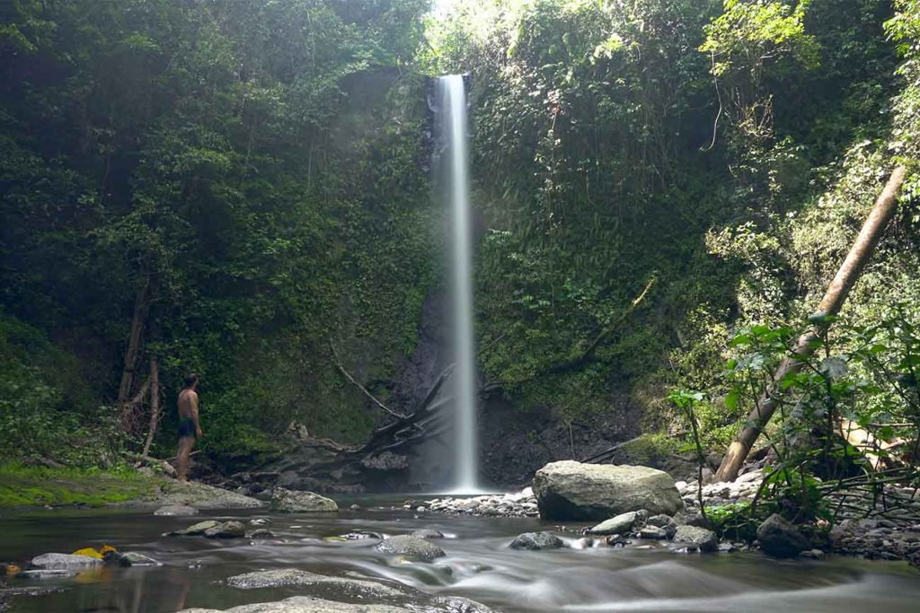 person looking at a waterfall in sao tome and principe