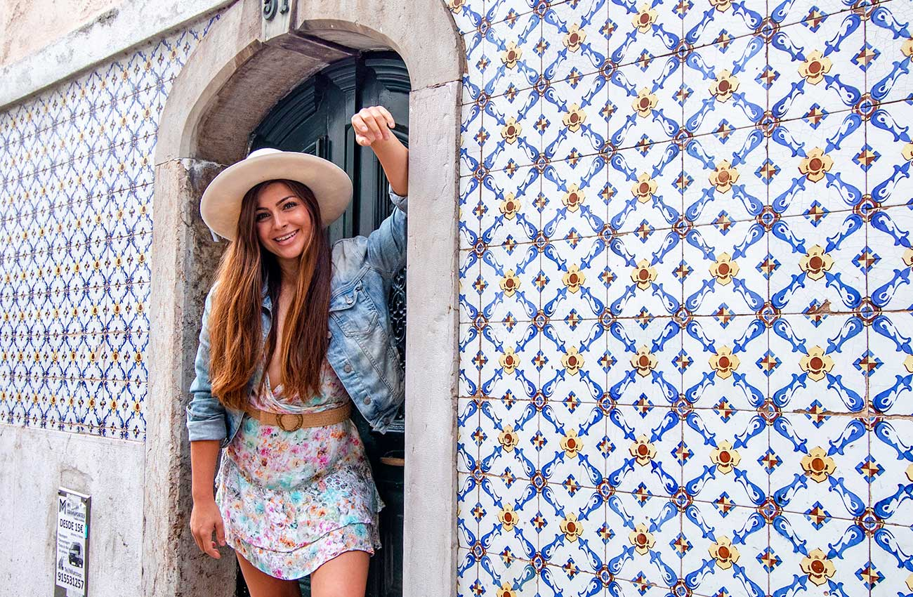 Melissa standing in a door in Alfama, showing us where to stay in Lisbon